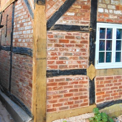 Oak corner post replaced on 16th Century cottage.