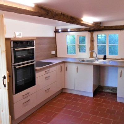 Part of the refurbishment work to a 16th Century cottage included fitting a new kitchen. There was a lot of scribing required!