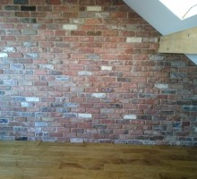 A loft conversion showing the newly installed brick slip wall with lime mortar pointing.